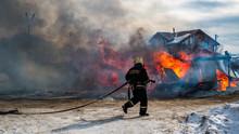 Firemen Extinguishes A Burning...