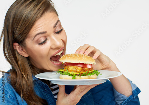 Foto woman eating big burger. Isolated portrait.