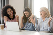 Diverse happy overjoyed female employees team excited by online win