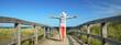 Leinwandbild Motiv aktive Frau genießt die Auszeit am Strand