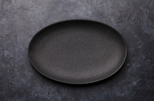 Empty Plate Over Kitchen Table