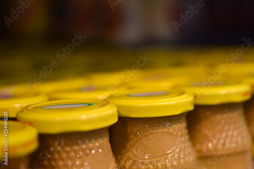 Mustard jars in the store Canvas Print