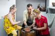master class in a pottery workshop for a family