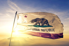 California State Of United States Flag Waving On The Top Sunrise Mist Fog