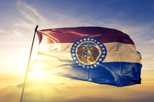 Missouri State Of United States Flag Waving On The Top Sunrise Mist Fog