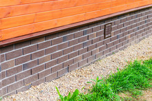 Foundation Plating With Imitation Brick In A Private House