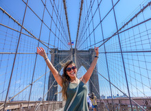 Happy Girl At The Brooklyn Bridge, New York