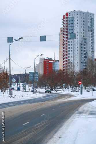 Photo Stands New York Moscow, Russia - March, 4, 2019: image of an empty highway in the background of residential buildings in winter in Moscow