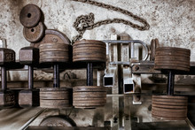 Rusted Dumbbells And Weights On A On A Rack In A Hardcore ,bodybuilders , Weight Room.