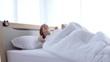 Attractive woman sleeping on bed in bedroom