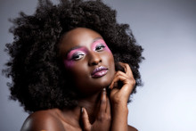 Afro And Flower Beauty With Big Black Hair Smooth Dark Skin  Does Stunning Poses For Studio Photography Shoot