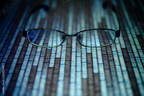 reading data in digital age  glasses and flowing binary code