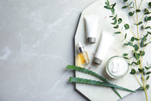 Flat Lay Composition With Different Body Care Products And Space For Text On Grey Background