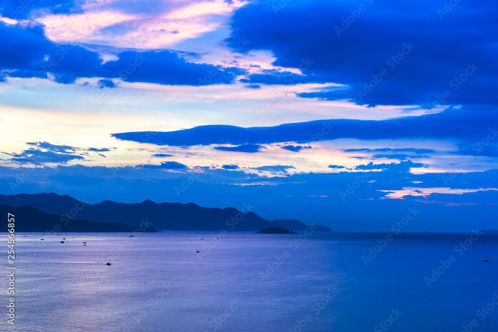 Fototapety, obrazy: sunrise with a dramatic cloudy sky over the beach