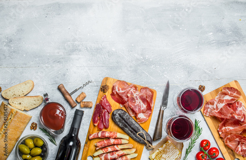 Antipasto background.Various Italian meat snacks. - 254585472