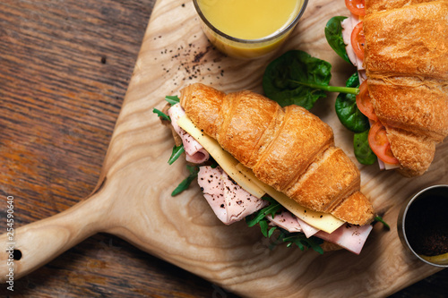 Foto op Canvas Snack Croissants catering Croissant sandwiches orange juice served wooden board