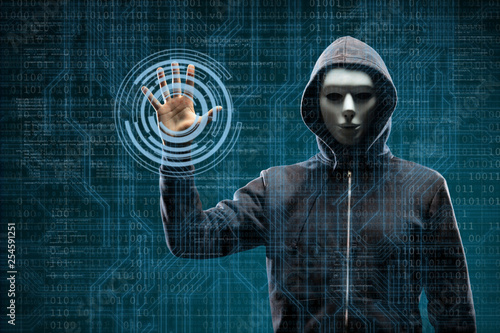 Fotografía Computer hacker in mask and hoodie over abstract binary background
