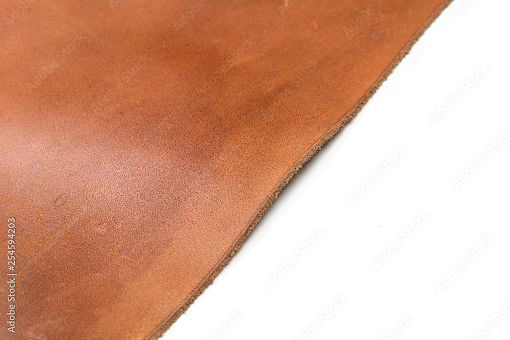 Fototapeta Tanned leather dyed in brown color