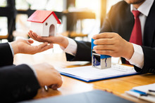 House Real Estate Sell Agent Reviews The Documents That Have Been Approved For The Home Buyer Loan.