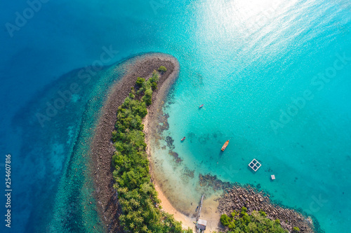 Wall Murals Island Amazing island with sand beach green tree forest aerial view