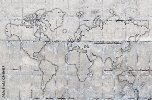 Photo  world map outline on concrete background