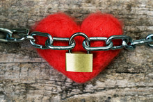 Red Toy Heart Wrapped With A Chain And Closed With A Metal Lock. Love Concept.