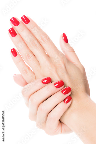 Cuadros en Lienzo Hands of a young woman with red manicure on nails