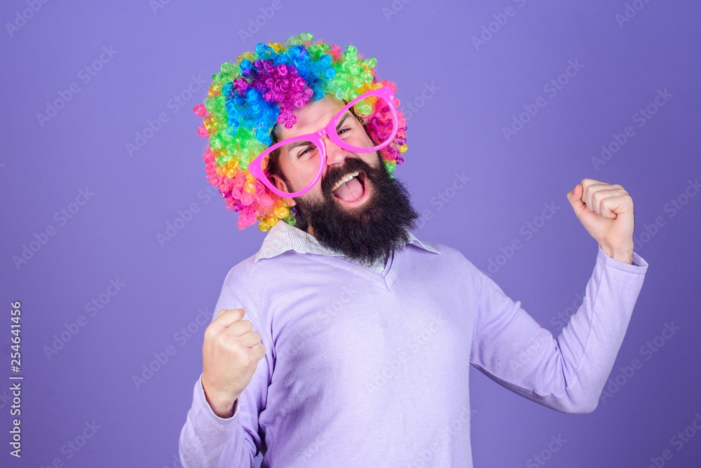 Fototapeta Having fun. Holiday fun and carnival concept. Man bearded wear colorful wig and funny glasses on violet background. Clown and circus. Party fun. Enjoy being crazy. Feel free to express yourself
