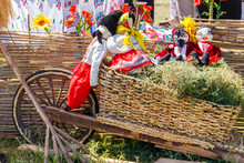 Wooden Cart With Handmade Dolls In Traditional Ukrainian Clothing For Decor During Fair