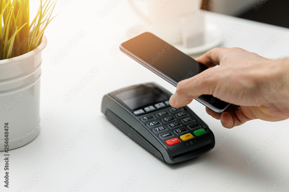 Fototapeta nfc contactless payments - paying bill with phone