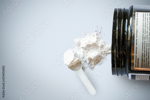 Fotografia  Sport supplement, creatine, hmb, bcaa, amino acid or vitamin mesure with powder