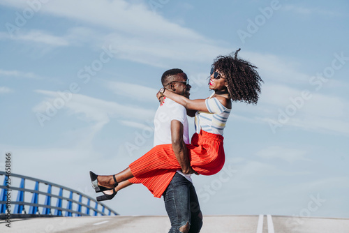 Fotografiet  Afro young couple having romantic moments
