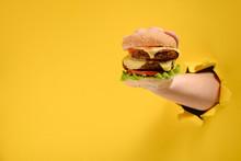 Hand Taking A Big Burger