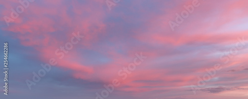 Photo Stands Candy pink Sunset or sunrise sky clouds, a beautiful pink, purple and blue sky with clouds. Natural cloudscape background. Panoramic view.