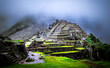 canvas print picture Amazing view of breathtaking Machupicchu temple covered with fog