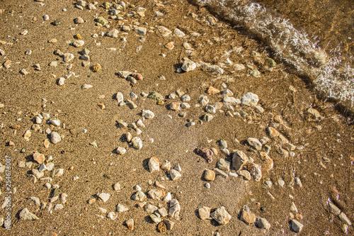 Fotografie, Obraz  sand stone beach shoreline nature background surface from above near wave photog