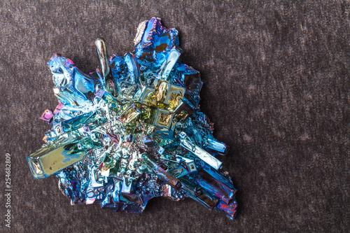 bismuth (rainbow metal) on the dark stone background Tablou Canvas
