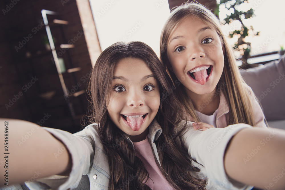 Fototapety, obrazy: Self-portrait of two nice lovely attractive charming cheerful cheery crazy careless naughty girls wearing casual showing tongue out having fun in house loft industrial interior