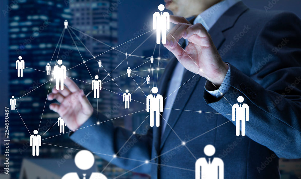 Fototapeta Business administrator in action of manpower or human resource planning or business organisation on a virtual dashboard.