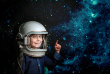 A Small Child Wants To Fly An Airplane Wearing An Airplane Helmet