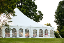 A White Wedding Tent Set Up In...