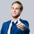 canvas print picture - businessman with thumbs up gesture