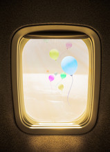 Flight Concept, Colorful Balloons Above The Clouds Seen From Window Airplane.