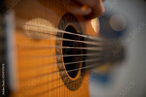 Vászonkép acoustic guitar on black background hand show live concert audio song recording