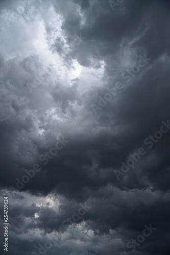 Fotografia Dark, grim, stormy, rainy sky with rays of light