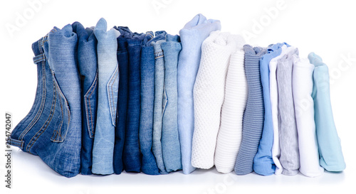 Fotografía  Stack blue jeans and clothes on white background isolation