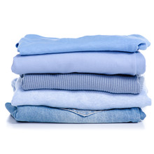 Stack Blue Clothes And Jeans On White Background Isolation