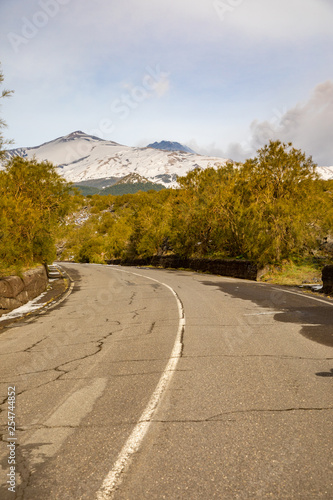 Vászonkép  Road to volcano and snow covered Etna Mount, Sicily, Italy