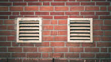 A Brick Wall With Two Vents