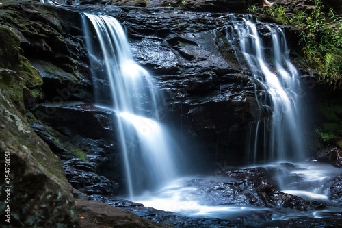 Tuinposter Watervallen waterfall in the forest